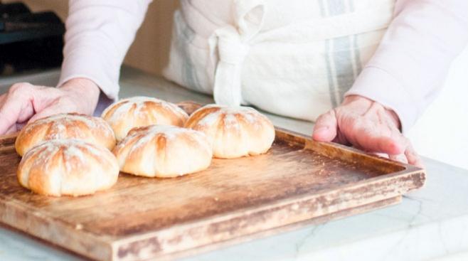 Sarah Black kneading organic whole wheat bread